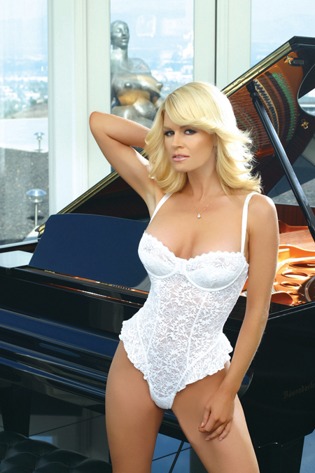 Sexy white stretch lace teddy with demi cups, ruffled legs and adjusable straps.